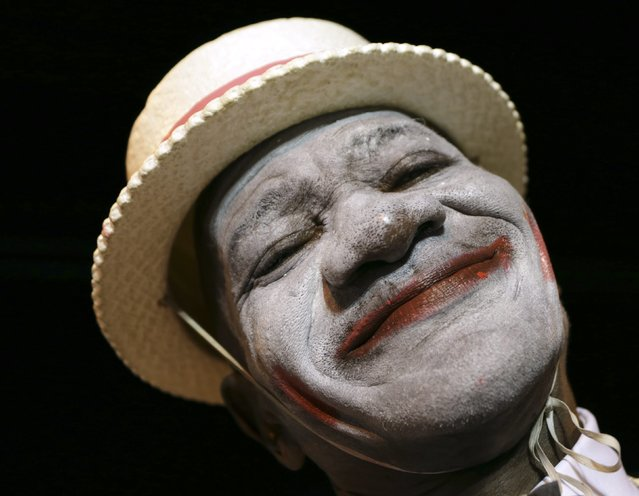 A minstrel, one of several masqueraders who paraded before judges in the traditional mas competition held by the National Carnival Commission at Victoria Square, smiles for a picture in the capital Port-of-Spain Februrary 11, 2015. The competition is one of several held in the weeks leading up to the traditional two-day Carnival street parade next Monday and Tuesday. (Photo by Andrea De Silva/Reuters)