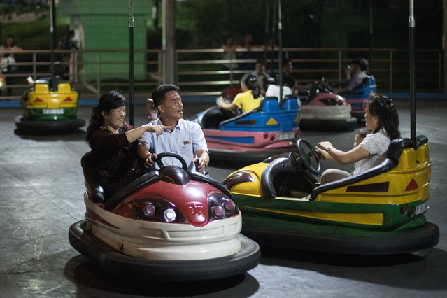 North Koreans play on the dodgems at Kaeson Youth Park on August 19, 2018 in Pyongyang, North Korea. (Photo by Carl Court/Getty Images)