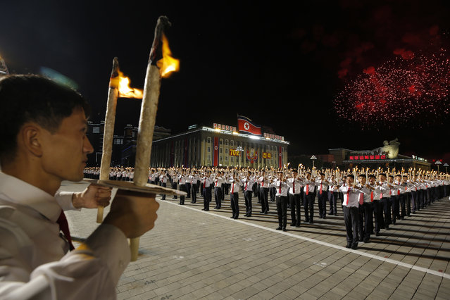 North Korean youths holding torches march during a torch light march at the Kim Il Sung Square in conjunction with the 70th anniversary of North Korea's founding day in Pyongyang, North Korea, Monday, September 10, 2018. (Photo by Kin Cheung/AP Photo)