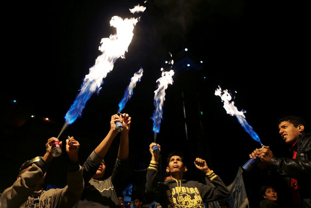 Libyans use portable torch burners during a procession celebrating the religious holiday of Mawlid al-Nabi, the birthday of Prophet Mohammad, in Benghazi, Libya December 10, 2016. (Photo by Esam Omran Al-Fetori/Reuters)