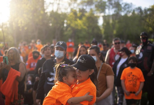 People gather in recognition of the discovery of children's remains at the site of a former residential school in Kamloops, B.C., in Edmonton Alta, on Monday, May 31, 2021. (Photo by Jason Franson/The Canadian Press)