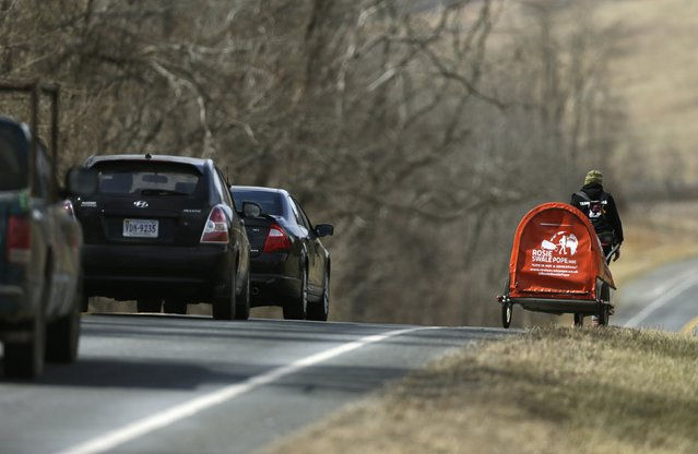 "Sixty-eight year old cross-country runner Rosie Swale-Pope is passed by traffic on US Route 50 while pulling her cart, ""The Icebird"", in Upperville, Virginia March 13, 2015. (Photo by Gary Cameron/Reuters)"