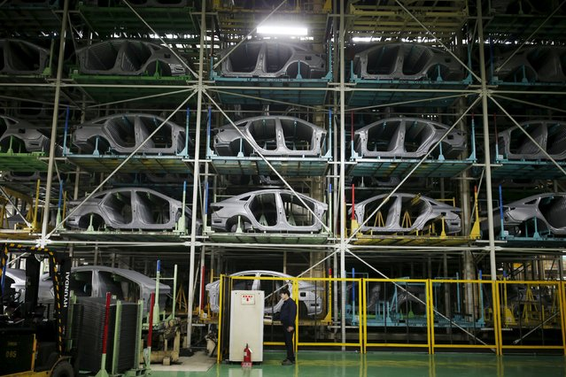 A worker stands in front of parts of Hyundai Motor's sedans at its plant in Asan, South Korea, January 27, 2016. (Photo by Kim Hong-Ji/Reuters)