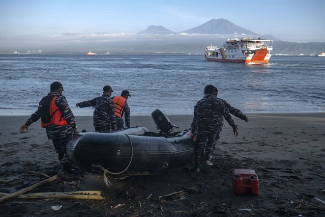 Indonesian Navy personnel prepare for a search rescue operation for victims of the sinking ferry KMP Yunice near Gilimanuk Port on Bali Island, Indonesia, Wednesday, June 30, 2021. Rescuers on Wednesday were searching for people missing in rough seas overnight. (Photo by Fauzy Chaniago/AP Photo)