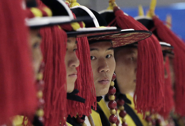 South Korean honor guards stand as they wait for the arrival of New Zealand Prime Minister John Key at Incheon International Airport in Incheon, South Korea, Sunday, March 22, 2015. Key arrived Sunday in South Korea for a three-day visit to discuss ways to strengthen cooperation in a wide range of issues, including trade and economy. (Photo by Ahn Young-joon/AP Photo)