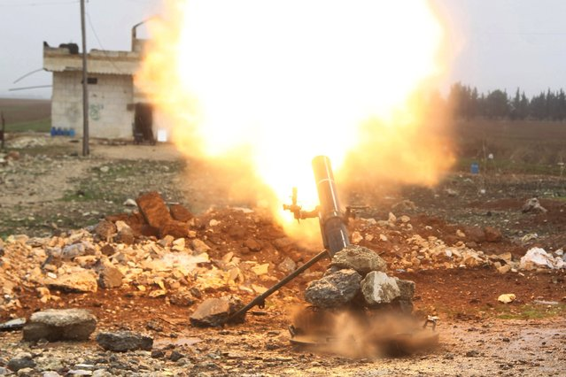 Free Syrian Army fighter fires a shell towards Islamic State fighters in the northern Aleppo countryside, Syria, January 18, 2016. (Photo by Abdelrahmin Ismail/Reuters)