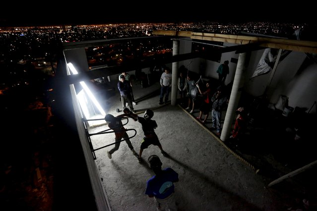 Residents take part in a boxing training session at the rooftop of an apartment, that is being used as a gym, as part of the Barrio Esperanza (Hope neighbourhood) project at the rough Cerro de la Campana neighbourhood in Monterrey, Mexico, January 29, 2016. The Barrio Esperanza project was started within the neighbourhood with the goal of improving the lives of the residents of the barrio through the introduction of health services, education, sports, employment opportunities and infrastructure upgrades, according to local media. (Photo by Daniel Becerril/Reuters)