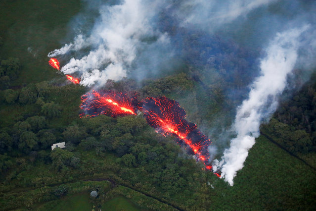 Lava erupts from a fissure east of the Leilani Estates subdivision during ongoing eruptions of the Kilauea Volcano in Hawaii, May 13, 2018. (Photo by Terray Sylvester/Reuters)