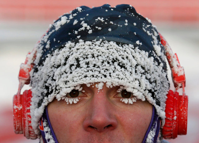 A runner with his face covered with hoarfrost competes during the traditional half Marathon amateur competition marking the Orthodox Christmas Day festivities, with the air temperature at about minus 24 degrees Celsius (minus 11.2 degrees Fahrenheit) in the Siberian city of Krasnoyarsk, Russia January 7, 2017. (Photo by Ilya Naymushin/Reuters)