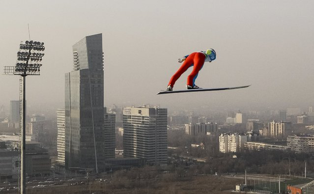 Ski Jumping, FIS Ski Jumping World Cup, First Round, Sunkar Ski Jumping complex, Almaty, Kazakhstan February 27, 2016: An athlete soars through the air during a first round. (Photo by Shamil Zhumatov/Reuters)
