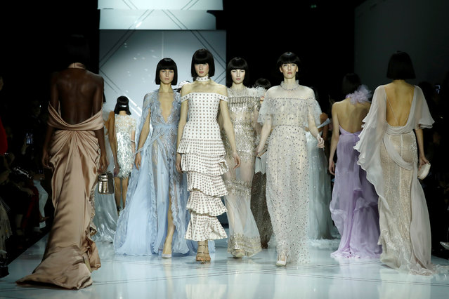 Models present creations by Australian designers Tamara Ralph and Michael Russo as part of their Haute Couture Spring/Summer 2017 fashion show for Ralph & Russo in Paris, France January 23, 2017. (Photo by Gonzalo Fuentes/Reuters)