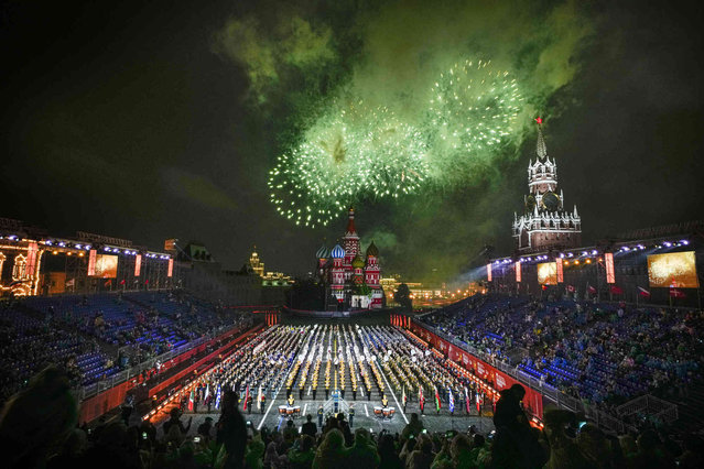 Fireworks explode as a combined military band of the participating countries performs during the Spasskaya Tower International Military Music Festival in Red Square with the St. Basil Cathedral in the background in Moscow, Russia, Thursday, August 26, 2021. (Photo by Alexander Zemlianichenko/AP Photo)