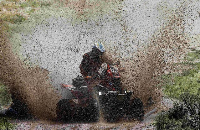 Gaston Rios Pablo of Argentina rides his quad during the first stage. (Photo by Jean-Paul Pelissier/Reuters)