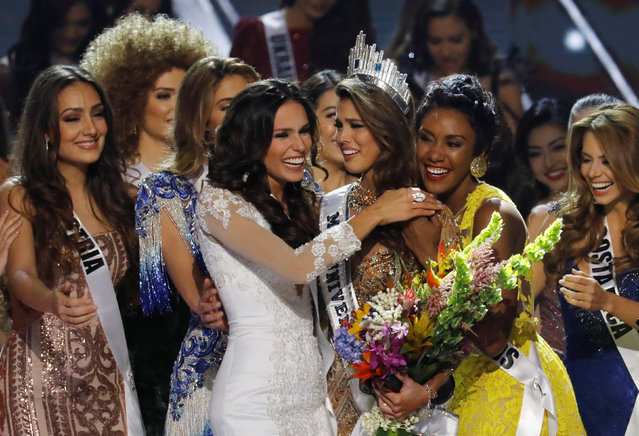 Contestants congratulate Miss France Iris Mittenaere after she won the 65th Miss Universe beauty pageant at the Mall of Asia Arena, in Pasay, Metro Manila, Philippines January 30, 2017. (Photo by Erik De Castro/Reuters)