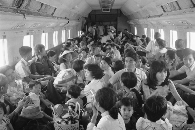 An aircraft operated by Air America, the central intelligence agency's charter airline, carries more than 100 refugees from Nhatrang to Saigon on Sunday, March 30, 1975. The plane was carrying twice its normal passenger load. (Photo by AP Photo)