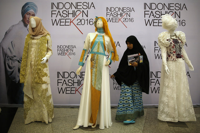 A student examines clothing on display at the Indonesia Fashion Week in Jakarta, Indonesia March 11, 2016. (Photo by Darren Whiteside/Reuters)
