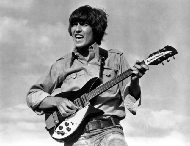 "Beatle George Harrison is shown playing the guitar in a scene from the Beatles movie ""Help!"" on location in the Bahamas in 1965. (Photo by AP Photo)"