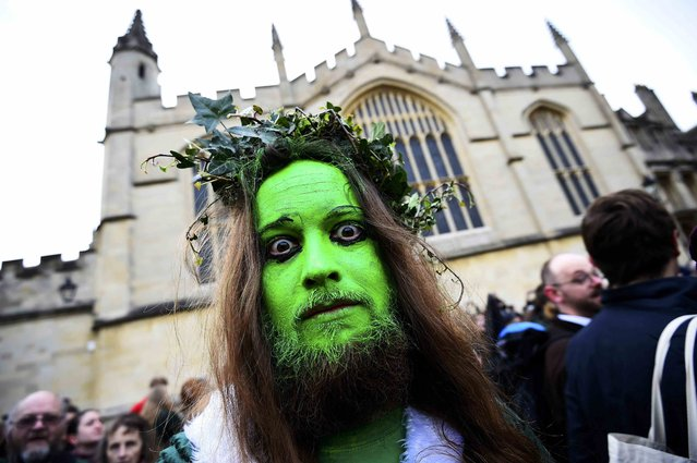A reveller walks through the streets in the early hours during traditional May Day celebrations in Oxford, Britain, May 1, 2015. (Photo by Dylan Martinez/Reuters)