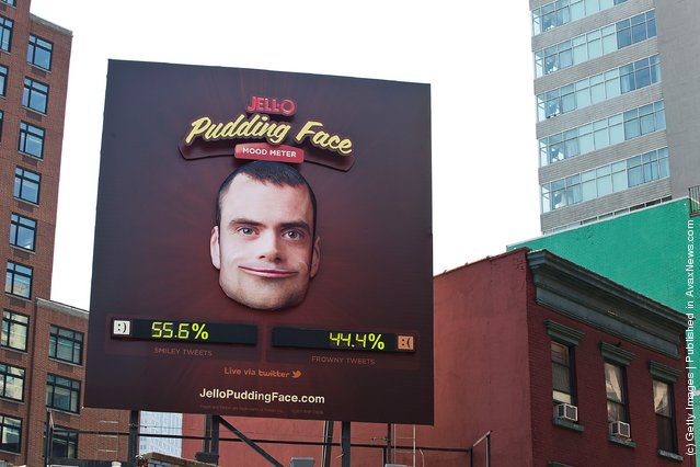 Billboard acts as a mood-meter by analyzing Twitter and guaging the number of happy and sad emoticons used at any given moment, causing the billboard's face to change between a smile and a frown