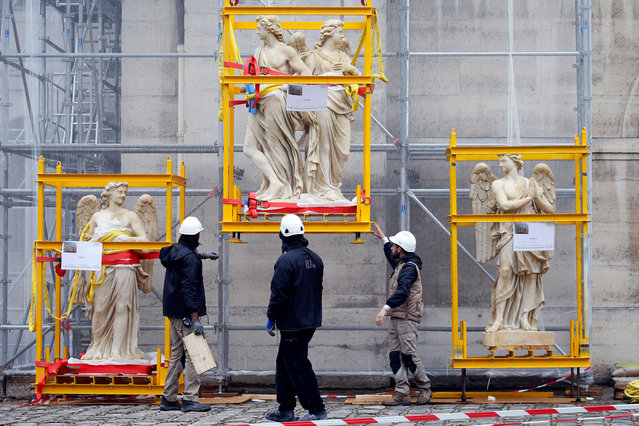 Sculptures in their transport cage are seen waiting for their installation on the dome of the Val-de-Grace church on April 10, 2019 in Paris, France. This is one of the largest stone cutting sites in France in recent years. The sculptures of the angels and genies of the dome of the Val-de-Grâce church, some of which have been deposited for some 24 years in order to be restored, will be replaced by copies. These sculptures, representing sixteen genies and eight angels have suffered heavily from erosion and atmospheric pollution. As the sculptures are far too fragile to be relocated and are important in the silhouette of the building which is a principal landmark the French State decided that they would be replaced by copies. (Photo by Chesnot/Getty Images)