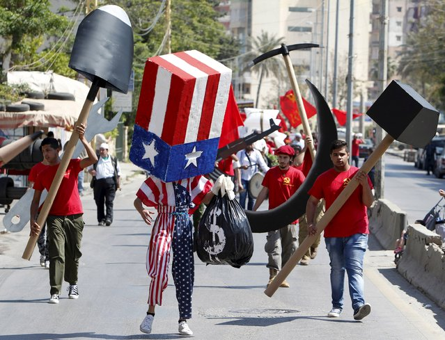 Protestors attend a march organised by the Lebanese Communist party carrying cut outs to mark Labour Day in Sidon, south Lebanon  May 3, 2015. International Workers' Day, also known as Labour Day or May Day, commemorates the struggle of workers in industrialised countries in the 19th century for better working conditions. (Photo by Ali Hashisho/Reuters)