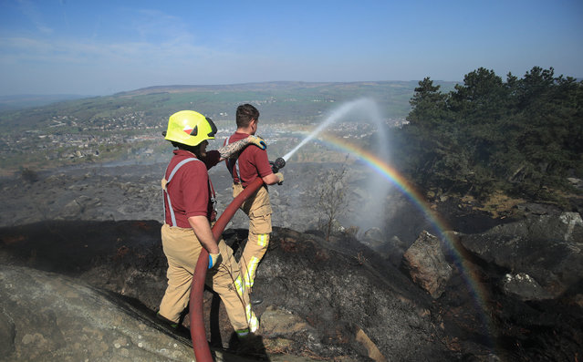 Firefighters tackle a large fire on Ilkley Moor in West Yorkshire, England on April 20, 2019. (Photo by Danny Lawson/PA Wire Press Association)