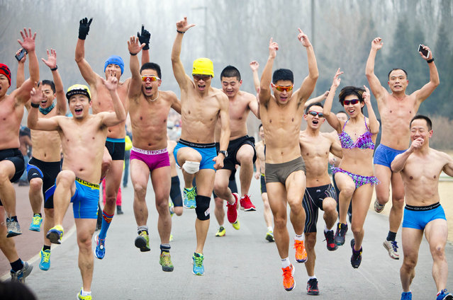 People take part in the annual 3.5 km undie run at Olympic Forst Park on February 23, 2014, in Beijing, China. (Photo by ChinaFotoPress/ChinaFotoPress via Getty Images)