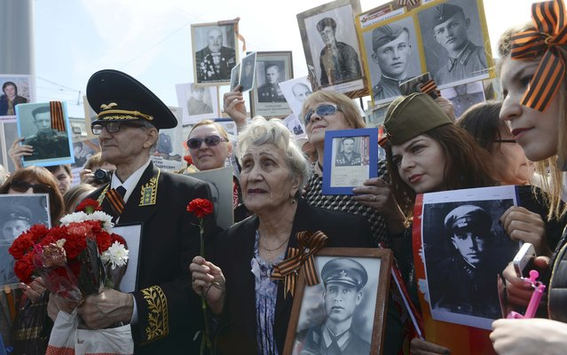 People take part in Immortal Regiment march with pictures of World War Two soldiers on Red Square during the Victory Day celebrations in Moscow, Russia, May 9, 2015. (Photo by Reuters/Host Photo Agency/RIA Novosti)
