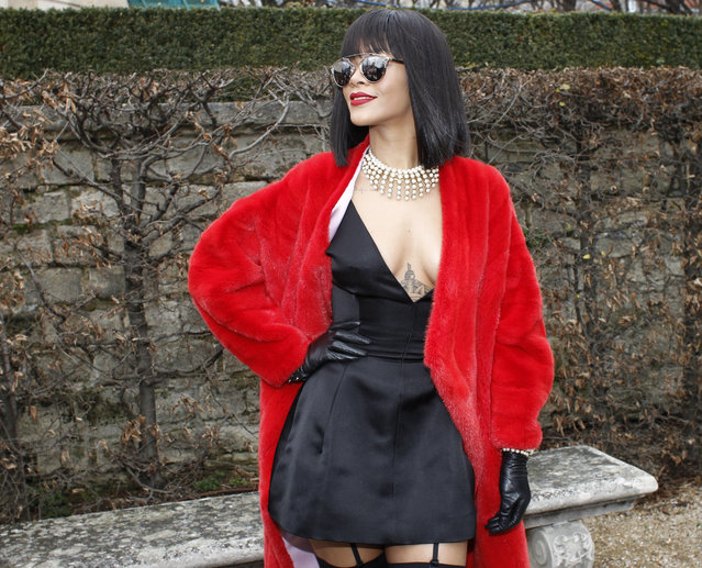 Singer Rihanna poses for photographers before Dior's ready-to-wear fall/winter 2014-2015 fashion collection presented in Paris, Friday, February 28, 2014. (Photo by Thibault Camus/AP Photo)