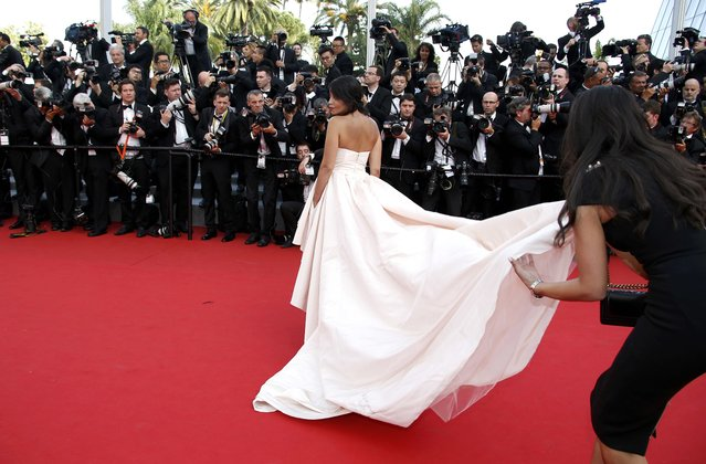 """Actress Leila Bekhti poses on the red carpet as she arrives for the opening ceremony and the screening of the film """"La tete haute"""" out of competition during the 68th Cannes Film Festival in Cannes, southern France, May 13, 2015. (Photo by Eric Gaillard/Reuters)"""