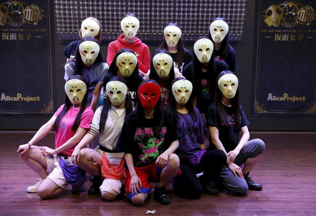 "Members of Japanese idol group Kamen Joshi (Masked Girls)  pose for a photo after a rehearsal for a concert at their theatre in Tokyo's Akihabara district, Japan March 17, 2016. For countless girl and pop-idol bands in Japan, standing out from the crowd can be daunting, but one group – ""Kamen Joshi"" – seems to have found the answer by hiding behind masks. The Tokyo-based all female band has 18 members, split into three groups that perform across Japan and elsewhere in Asia. (Photo by Toru Hanai/Reuters)"