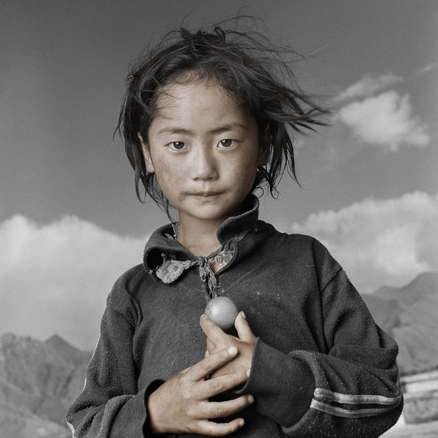 """Yama came with her parents and three sisters on a 6 week pilgrimage to the Jokhang Temple in Lhasa from the province of Kham. ""Yama helped carry our 10 month old daughter much of the way"". Her father said. ""We noticed very early that she was born with the true spirit of wanting to help others"". (Phil Borges)"