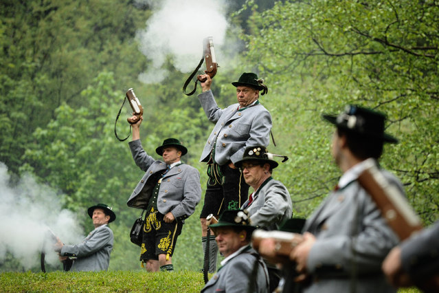 Marksmen in traditional Bavarian folk dress with salute guns fire their salute during the annual Ascension Mass (in German called Christi Himmelfahrt) at the open-air altar at Birkenstein on May 14, 2015 near Fischbachau, Germany. (Photo by Philipp Guelland/Getty Images)