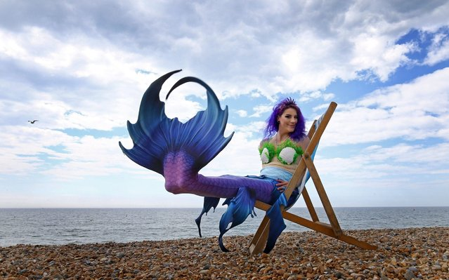 Mermaid Jasz Vegas poses on the beach during the changeable weather in Brighton, England on May 25, 2019 as Sea Life Brighton marks the opening of their day/night experience. (Photo by Gareth Fuller/PA Wire Press Association)
