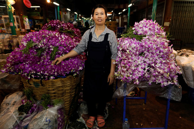 """Ram, 46, poses for a photograph at her stall at the flower market in Bangkok, Thailand, February 26, 2017. """"In this market men do the hard jobs, they carry heavy things, load trucks"""", said Ram. (Photo by Jorge Silva/Reuters)"""