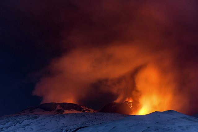 Snow-covered Mount Etna, Europe's most active volcano, spews lava during an eruption in the early hours of Thursday, March 16, 2017. A new eruption which began on March 15 is causing no damages to Catania's airport which is fully operational. (Photo by Salvatore Allegra/AP Photo)