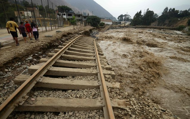View of sections of the central railroad track that follows the Rimac River, which suffered severe damage by rising water and flash foods in the town of Chosica, at the foot of the Andes mountains east of Lima, on March 18, 2017. (Photo by Cris Bouroncle/AFP Photo)