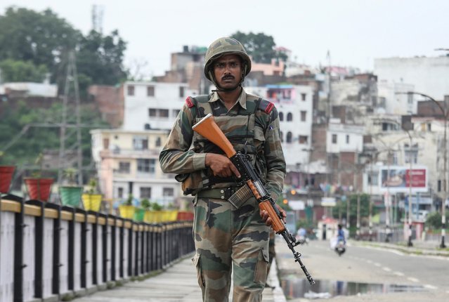 An Indian army soldier patrols on a bridge during restrictions in Jammu, August 5, 2019. (Photo by Mukesh Gupta/Reuters)