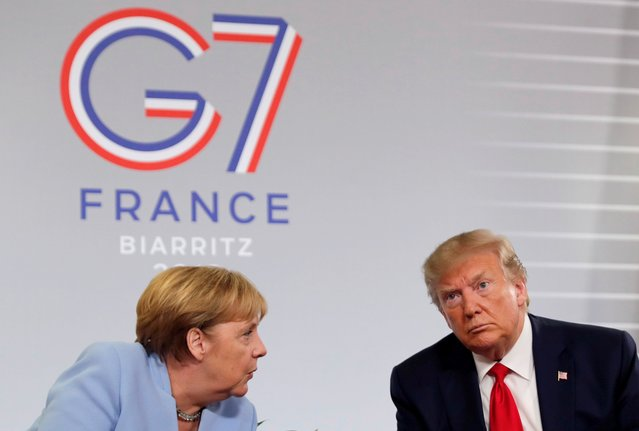 U.S. President Donald Trump meets German Chancellor Angela Merkel for bilateral talks during the G7 summit in Biarritz, France, August 26, 2019, 2019. (Photo by Carlos Barria/Reuters)