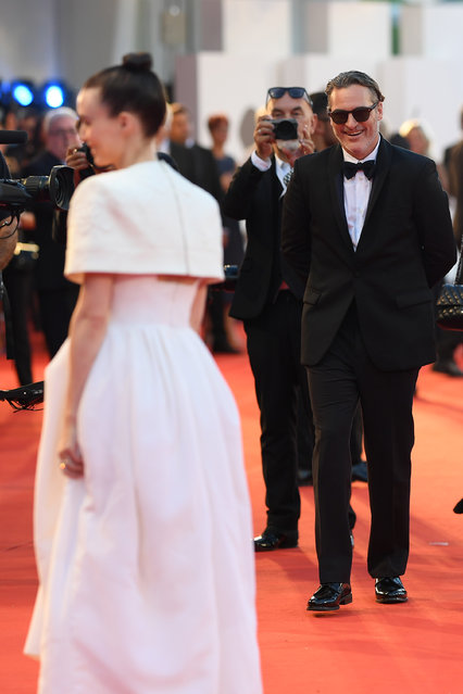 "Rooney Mara and Joaquin Phoenix walk the red carpet ahead of the ""Joker"" screening during the 76th Venice Film Festival at Sala Grande on August 31, 2019 in Venice, Italy. (Photo by Pascal Le Segretain/Getty Images)"