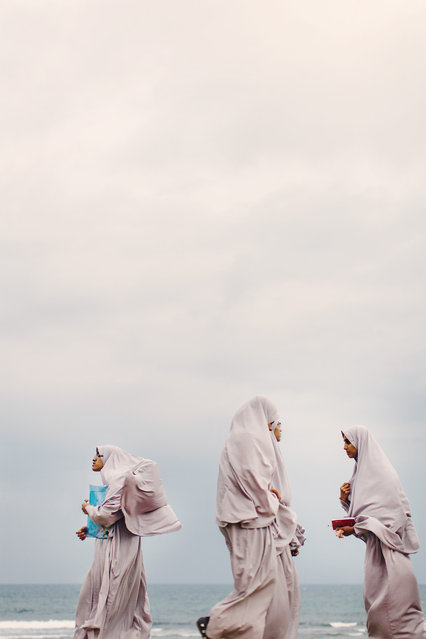 """""""Women of Sri Lanka"""". Captured in Sri Lanka at the Galle Fort, these women walked at dusk after the sun had just set in progression together along the seaside. Their beautiful energy could be felt a mile away. A joy to photograph. Photo location: Galle, Sri Lanka. (Photo and caption by Emma Willetts/National Geographic Photo Contest)"""