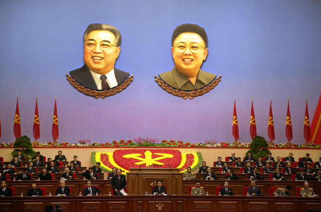 The portraits of late North Korean leaders Kim Il Sung, left, and Kim Jong Il hang inside the convention hall of the April 25 House of Culture where the party congress is held in Pyongyang, North Korea, Monday, May 9, 2016. (Photo by Wong Maye-E/AP Photo)