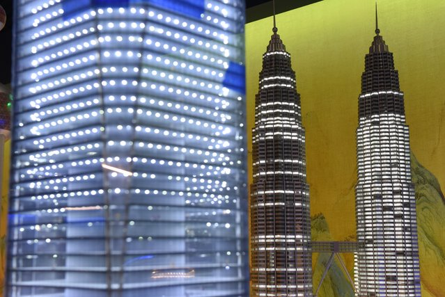 A miniature model of the Petronas Twin Towers in Kuala Lumpur, Malaysia, part of Gulliver's Gate, a miniature world being recreated in a 49,000-square-foot exhibit space in Times Square, is seen during a preview April 10, 2017. (Photo by Timothy A. Clary/AFP Photo)