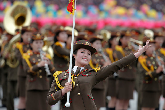 Uniformed participant dance during a mass rally and parade in the capital's main ceremonial square, a day after the ruling party wrapped up its first congress in 36 years by elevating him to party chairman, in Pyongyang, North Korea, May 10, 2016. (Photo by Damir Sagolj/Reuters)