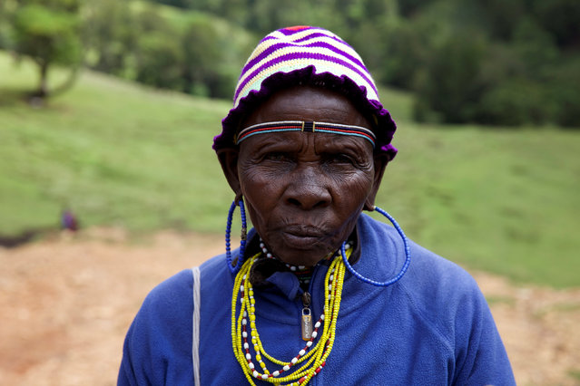 A woman from the Sengwer community poses for a photograph after protesting over their eviction from their ancestral lands, Embobut Forest, by the government for forest conservation in western Kenya, April 19, 2016. (Photo by Katy Migiro/Reuters)