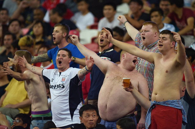 Stoke City fans cheer as their team plays the Singapore Selection in the Barclays Asia Trophy soccer match in Singapore, Saturday, July 18, 2015. (Photo by Joseph Nair/AP Photo)