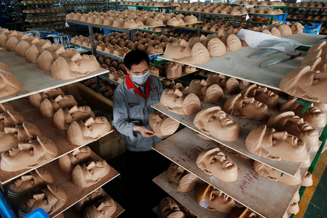 A worker checks a mask of U.S. Republican presidential candidate Donald Trump at Jinhua Partytime Latex Art and Crafts Factory in Jinhua, Zhejiang Province, China, May 25, 2016. (Photo by Aly Song/Reuters)