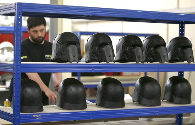 "A technician works next to shelf holding replicas of Kylo Ren's helmet from ""Star Wars: The Force Awakens"", in the Propshop headquarters at Pinewood Studios near London, Britain May 25, 2016. (Photo by Peter Nicholls/Reuters)"