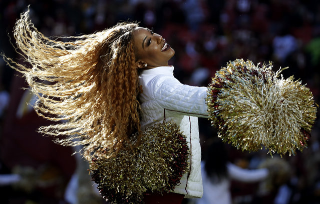 A Washington Redskins cheerleader perfrorms during the first half of an NFL football game against the Detroit Lions, Sunday, November 24, 2019, in Landover, Md. (Photo by Alex Brandon/AP Photo)