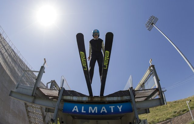 A skier jumps during training session at the Sunkar Ski Jumping complex in Almaty, Kazakhstan, July 15, 2015. (Photo by Shamil Zhumatov/Reuters)